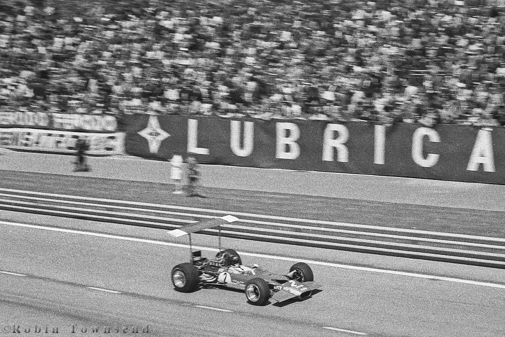 Austrian driver,,Jochen Rindt, drives past the the pit lane in his Lotus 49 during the 1969 Spanish Grand Prix at the Montjuïc urban circuit in Barcelona, Spain.