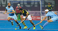 BHUBANESWAR (India) -  Hero Champions Trophy hockey men. Semifinal India vs Pakistan. Shafgat Rasool (Pakistan) passes Sardar Singh of India (l) and Gurjinder Singh of India. Photo Koen Suyk