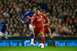 LIVERPOOL, ENGLAND - Tuesday, March 13, 2012: Liverpool's Luis Alberto Suarez Diaz in action against Everton's Marouane Fellaini during the Premiership match at Anfield. (Pic by David Rawcliffe/Propaganda)