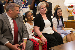 Joshua Holt's father Jason Holt(left), daughter Marian Leal (2nd left), mother Laurie Holt(2nd right) and spouse Thamara Caleño listen during a meeting with Holt and United States President Donald J. Trump upon his return to the U.S. at The White House in Washington, DC, May 26, 2018. Holt, was released from prison in Venezuela following diplomat efforts by the Obama and Trump administrations. Credit: Chris Kleponis / CNP
