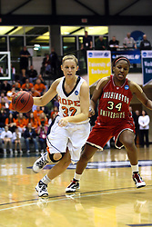 20 March 2010: Erika Bruinsma storms in passing the 3 point mark and Janice Evans. The Flying Dutch of Hope College fall to the Bears of Washington University 65-59 in the Championship Game of the Division 3 Women's NCAA Basketball Championship the at the Shirk Center at Illinois Wesleyan in Bloomington Illinois.