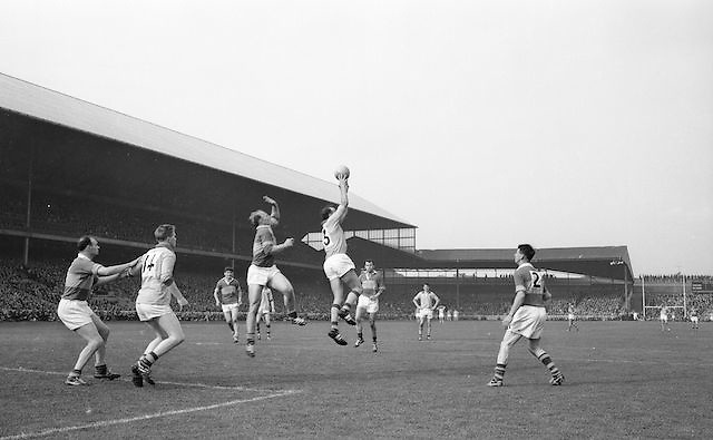 Roscommon's D. Feeley jumps and gains possession of the ball during the All Ireland Senior Gaelic Football Championship Final Kerry v Roscommon in Croke Park on the 23rd September 1962. Kerry 1-12 Roscommon 1-6.