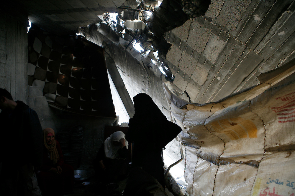 A Palestinian family remain in their home after it was mostly destroyed by Israel in Jabaliya in the Gaza Strip.