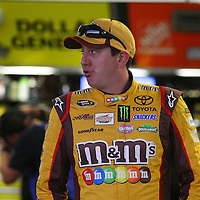 Driver Kyle Busch whistles while waiting to practice during the  56th Annual NASCAR Daytona 500 practice session at Daytona International Speedway on Wednesday, February 19, 2014 in Daytona Beach, Florida.  (AP Photo/Alex Menendez)