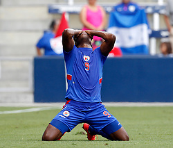 Haiti's Kervens Belfort reacts after getting an assist on a goal against Honduras during the first half of a CONCACAF Gold Cup soccer match, Monday, July. 13, 2015, in Kansas City, Kan. (AP Photo/Colin E. Braley)