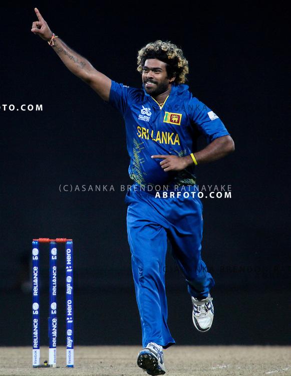 Sri Lankan bowler Lasith Mailnga celebrates after getting a wicket during the T20 Cricket World super 8's match between England Vs Sri Lanka at the Pallekele International Stadium Cricket Stadium, Pallekele. Photo credit : Asanka Brendon Ratnayake
