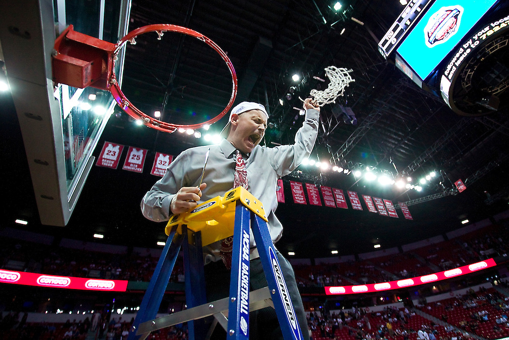 Anthony Levrets, head coach of the University of Utah woman's basketball team cuts the net at the 2010 Mountain West Championship Tournament.  <br /> <br /> Photo By: Nathan Sweet