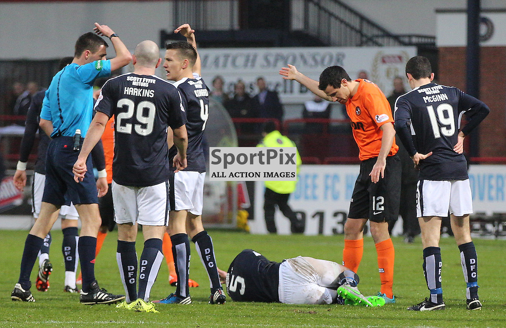 Dundee v Dundee United Scottish Premiership 2 January 2016; James McPake (Dundee, 5) suffers a serious knee injury in a challenge with John Rankin (Dundee United, 8) during the Dundee v Dundee United Scottish Premiership match played at Dens Park Stadium;