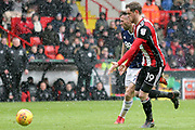Richard Stearman of Sheffield United (19) and Daryl Murphy of Nottingham Forest (9) during the EFL Sky Bet Championship match between Sheffield United and Nottingham Forest at Bramall Lane, Sheffield, England on 17 March 2018. Picture by Mick Haynes.