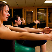 Alexis Colangelo (back) leads Jeri Kott (middle) and Rebecca Price during a pilates session at Pure Pilates Hair and Body.