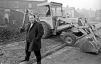 Paddy Devlin, MP, N Ireland Labour Party, at an illegal building site off the Crumlin Road in Belfast. The Bombay Street Housing Association had an involvement in the venture. 12th December 1969. 196912120261<br /> <br /> Copyright Image from Victor Patterson, 54 Dorchester Park, <br /> Belfast, UK, BT9 6RJ<br /> <br /> t1: +44 28 9066 1296 (from Rep of Ireland 048 9066 1296)<br /> t2: +44 28 9002 2446 (from Rep of Ireland 048 9002 2446)<br /> m: +44 7802 353836<br /> <br /> e1: victorpatterson@me.com<br /> e2: victorpatterson@gmail.com<br /> www.victorpatterson.com<br /> <br /> Please see my Terms and Conditions of Use at www.victorpatterson.com. It is IMPORTANT that you familiarise yourself with them.<br /> <br /> Images used on the Internet must be visibly watermarked i.e. © Victor Patterson<br /> within the body of the image and copyright metadata must not be deleted. Images <br /> used on the Internet have a size restriction of 4kbs and will be chargeable at current<br />  NUJ rates unless agreed otherwise.<br /> <br /> This image is only available for the use of the download recipient i.e. television station, newspaper, magazine, book publisher, etc, and must not be passed on to any third <br /> party. It is also downloaded on condition that each and every usage is notified within 7 days to victorpatterson@me.com<br /> <br /> The right of Victor Patterson to be identified as the author is asserted in accordance with The Copyright Designs And Patents Act (1988).