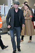 "28.FEBRUARY.2012. PARIS<br /> <br /> JEAN DUJARDIN IS SEEN ARRIVING AT ROISSY CHARLES DE GAULLE AIRPORT FROM LOS ANGELES ALONG WITH HIS FRIEND GILLES LELLOUCHE TUESDAY AFTERNOON. THE ACTOR WHO JAS JUST WON THE OSCAR FOR BEST ACTOR FOR HIS PERFORMANCE IN ""THE ARTIST"" WAS WELCOMED BY DOZENS OF JOURNALISTS AND FANS.  <br /> <br /> BYLINE: EDBIMAGEARCHIVE.COM<br /> <br /> *THIS IMAGE IS STRICTLY FOR UK NEWSPAPERS AND MAGAZINES ONLY*<br /> *FOR WORLD WIDE SALES AND WEB USE PLEASE CONTACT EDBIMAGEARCHIVE - 0208 954 5968*"