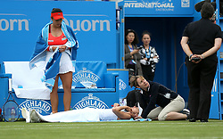Switzerland's Martina Hingis receives some treatment during the Women's Doubles Final as Chinese Taipei's Yung-jan Chan looks on during day nine of the AEGON International at Devonshire Park, Eastbourne. PRESS ASSOCIATION Photo. Picture date: Saturday July 1, 2017. See PA story TENNIS Eastbourne. Photo credit should read: Steven Paston/PA Wire. RESTRICTIONS: Editorial use only, no commercial use without prior permission.