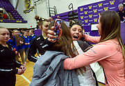 Mitchell High School junior Maria Krall is swarmed by friends after the awards ceremony where Mitchell captured the Class AA State Championship following the state gymnastics meet on Friday at the Watertown Civic Arena. (Matt Gade / Republic)