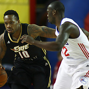 Erie BayHawks Guard Nick Covington (10) dribbles the ball up court as Delaware 87ers Guard Mfon Udofia (12) defends in the second half of a NBA D-league regular season basketball game between the Delaware 87ers (76ers) and the Erie BayHawks (Knicks) Monday, Jan 13, 2014 at The Bob Carpenter Sports Convocation Center, Newark, DE