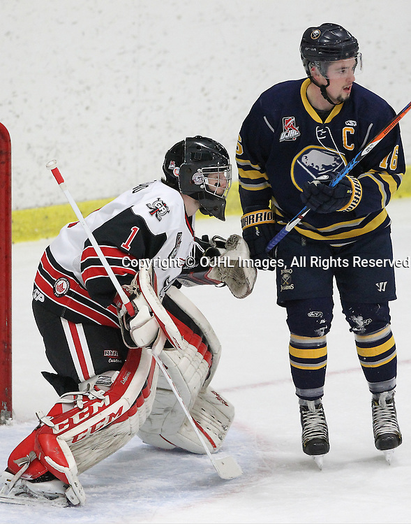 GEORGETOWN, ON  - MAR 2,  2017: Ontario Junior Hockey League, playoff game between the Georgetown Raiders and the Buffalo Jr Sabres. Josh Astorino follows the play as Brendan Dunning #16 of the Buffalo Jr. Sabres sets up the screen during the first period.<br /> (Photo by Tim Bates / OJHL Images)