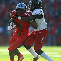 Wide receiver Leonte Carroo runs through a tackle during American Athletic Conference Football action between Rutgers and Cincinnati on Nov. 16, 2013 at High Point Solutions Stadium in Piscataway, New Jersey.
