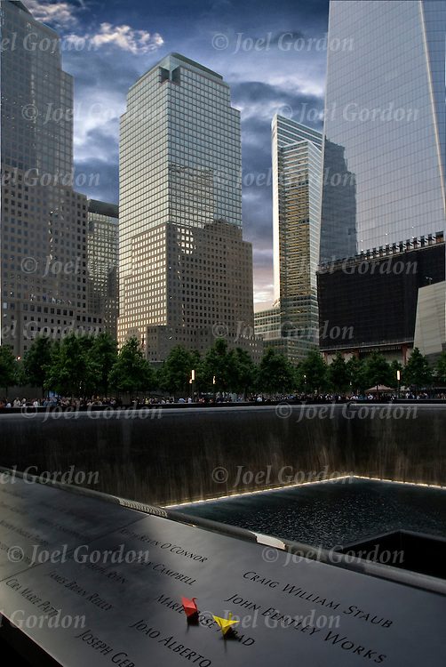 The memorial occupies half of the 16-acre World Trade Center site. Twin reflecting pools with cascading waterfalls are set within the one-acre footprints of the original twin towers. It is 176 feet in perimeter, and the waterfalls are 30 feet deep from street level.  The 2,983 names of the victims of the attacks of Sept. 11, 2001, and Feb. 26, 1993, World Trade Center truck bombing are inscribed into bronze parapets surrounding the twin memorial pools.