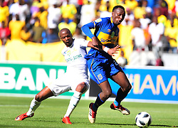 Cape Town--180401  Cape Town City midfielder striker Sibusiso masina challenged by Tebogo Lengerman of Mamelodi Sundowns during the Nedbank Cup quarter final game at the Cape Town Stadium.Sundowns won the game 2-1 and will play maritzburg in the Semi-final  .Photographer;Phando Jikelo/African News Agency/ANA