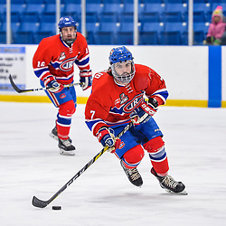 OAKVILLE, ON  - FEB 23,  2018: Ontario Junior Hockey League game between the Oakville Blades and the Toronto Jr. Canadiens, Anthony Paveglio #7 of the Toronto Jr. Canadiens skates with the puck during the second period.<br /> (Photo by Ryan McCullough / OJHL Images)