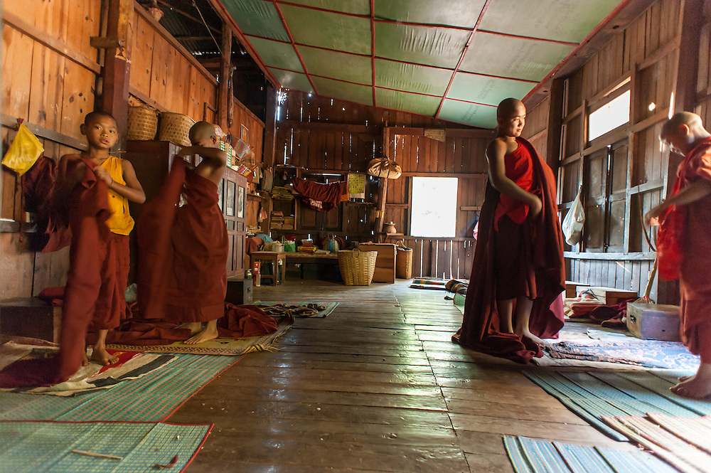 Novice Buddhist monks dressing up in the morning (Myanmar)