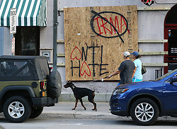 Eric and Nicole Zajkowski, who just fled Hurricane Irma from their home in Coral Springs, Fla., pass by a boarded up store in Savannah, Ga., walking their dog Neeko on Friday, Sept. 8, 2017. The city of Savannah is under mandatory evacuation by Saturday, and the couple said they will have to evacuate a second time. Photo byCurtis Compton/Atlanta Journal-Constitution/TNS/ABACAPRESS.COM
