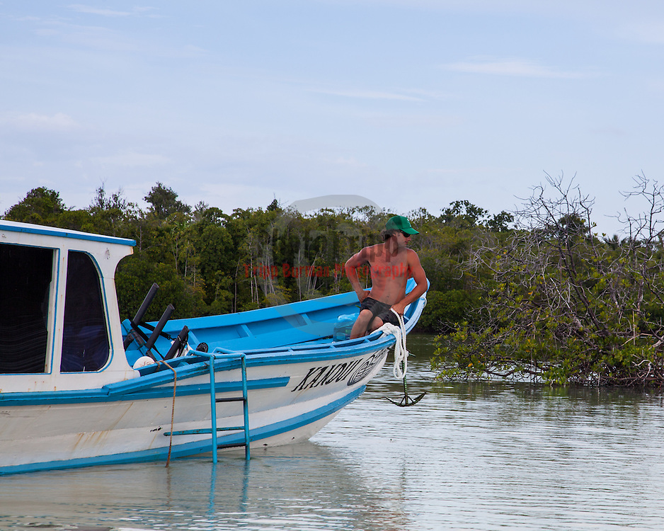 Playing in the mangroves at Kandui, Mentawais Islands, Indonesia.