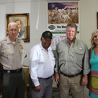 RAY VAN DUSEN/BUY AT PHOTOS.MONROECOUNTYJOURNAL.COM<br /> From left, Amory board attorney Sam Griffie, Sheriff Cecil Cantrell, Ward 2 Alderman John Darden, Attorney General Jim Hood, Monroe County Prosecuting Attorney Candy Blalock and Mayor Brad Blalock pose for a picture in the lobby of Wax Seed Company.
