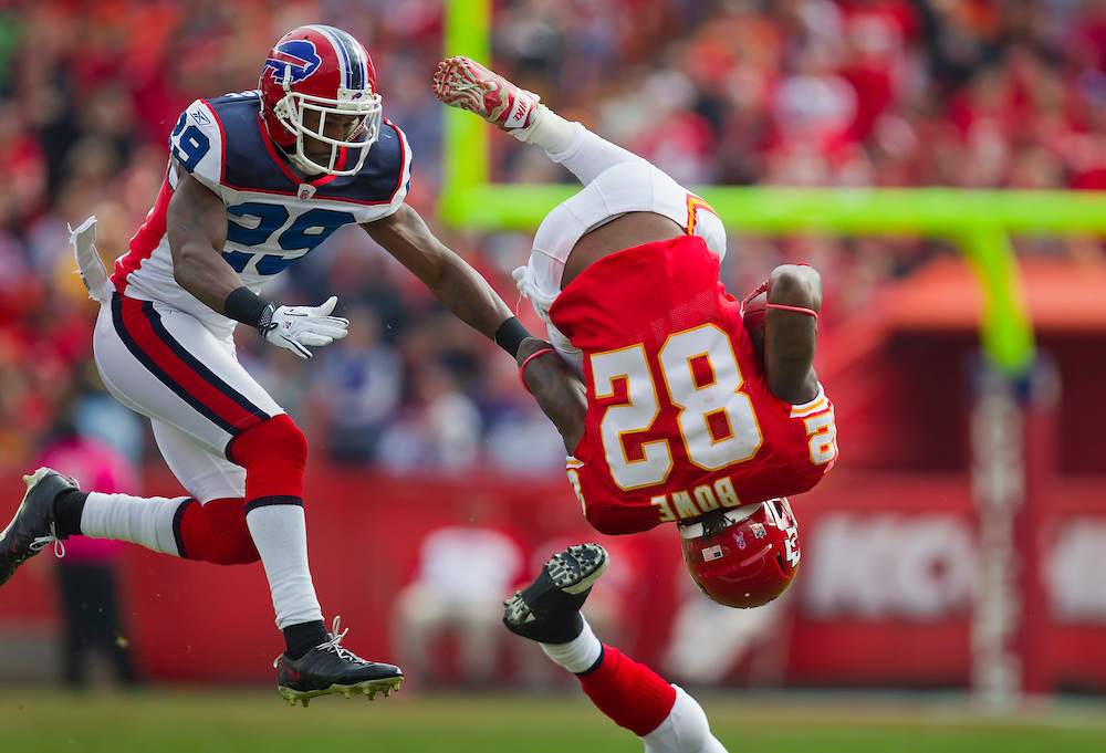Kansas City Chiefs wide receiver Dwayne Bowe (82) was flipped on a tackle in the first half, pursued by Buffalo Bills cornerback Drayton Florence (29), left, at Arrowhead Stadium in Kansas City, Mo. on October 31, 2010. The Chiefs won 13-10 in overtime.