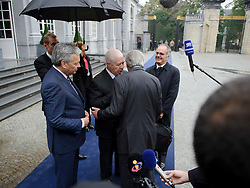 Didier Reynders, Belgium's finance minister, left, and Jean-Claude Juncker, Luxembourg's prime minister, and president of the Eurogroup, right, speak with Fernando Teixeira Dos Santos, Portugal's finance minister, center, as they arrive for the Eurogroup finance ministers meeting in Brussels, Thursday, Sept. 30, 2010. (Photo © Jock Fistick)