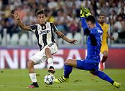 © Filippo Alfero<br /> Juventus-Siviglia, Champions League 2016/2017<br /> Torino, 14/09/2016<br /> sport calcio<br /> Nella foto: Paulo Dybala Juventus, Sergio Rico Sevilla