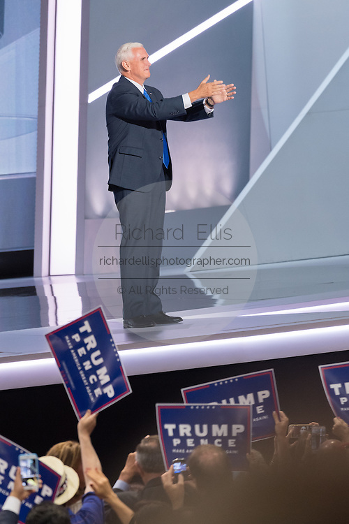 Gov. Mike Pence points toward his family sitting in the stands as he walks onstage to addresses delegates and accept the nomination as GOP Vice Presidential  candidate during the third day of the Republican National Convention July 20, 2016 in Cleveland, Ohio.