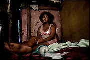 "Sennait, 21 years old, lies on the bed in her shack, based in a red light area of Addis Ababa. Sold at the age of 8 years, manages to escape from the man who abused her. His greatest desire is to rebuild a true life. The girls who are forced to marry face a number of problems, and often suffer health problems as a result of having sexual relations from an early age. These girls are being violated physically and emotionally. Child marriage was a major issue raised by the 2007 United Nations Commission on the Status of Women. A U.S. resolution to reduce the practice was passed, encouraging countries to take actions. In Ethiopia the legal age to get married is 18, the law quite often is ignored. Addis Ababa, Ethiopia, on thursday, Febrary 19 2009.....In a tangled mingling of tradition and culture, in the normal place of living, in a laid-back attitude. The background of Ethiopia's ""child brides"", a country which has the distinction of having highest percentage in the practice of early marriages despite having a law that establishes 18 years as minimum age to get married. Celebrations that last days, their minds clouded by girls cups of tella and the unknown for the future. White bridal veil frame their faces expressive of small defenseless creatures, who at the age ranging from three to twelve years shall be given to young brides men adults already...To protect the identities of the recorded subjects names and specific places are fictional."