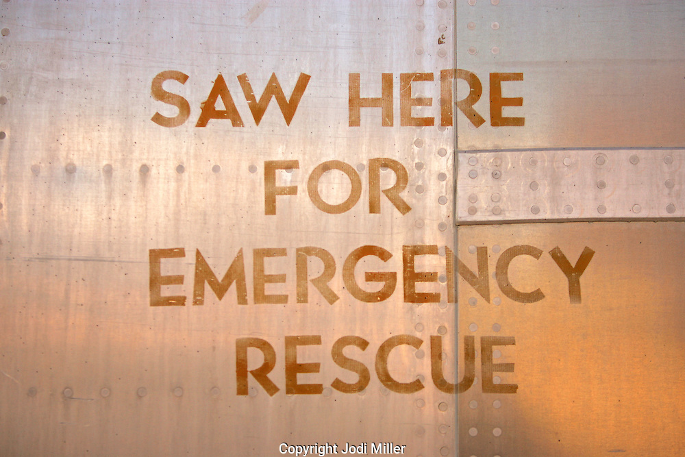 Saw here for emergency rescue stenciled on the side of a plane.