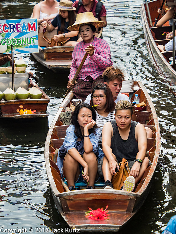 27 SEPTEMBER 2016 - BANGKOK, THAILAND:  Tourists in the floating market in Damnoen Saduak, Thailand. The market is famous because vendors cruise the canals around the market selling produce and tourist curios. It is one of the best known tourist attractions in Samut Songkhram province.     PHOTO BY JACK KURTZ
