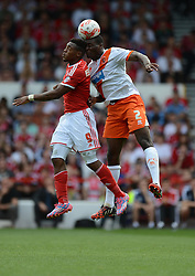 Nottingham Forest's Britt Assombalonga battles for a high ball with BlackPool's Donervon Daniels - Photo mandatory by-line: Alex James/JMP - Mobile: 07966 386802 09/08/2014 - SPORT - FOOTBALL - Nottingham - City Ground - Nottingham Forest v Blackpool - Sky Bet Championship - First game of the season