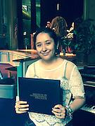 Luz De Leon receives her Passport Award.