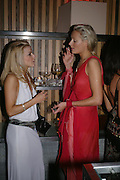 Louise Bartes and Kalita Al Swaidi.  Andy & Patti Wong's Chinese New Year party to celebrate the year of the Rooster held at the Great Eastern Hotel, Liverpool Street, London.29th January 2005. The theme was a night of hedonism in 1920's Shanghai. . ONE TIME USE ONLY - DO NOT ARCHIVE  © Copyright Photograph by Dafydd Jones 66 Stockwell Park Rd. London SW9 0DA Tel 020 7733 0108 www.dafjones.com