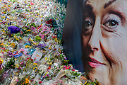 The advertising face of a middle-aged lady symbolises compassion and sympathy at the shrine of flowers and compassionate messages ten days after the terrorist attack on London Bridge and Borough Market, on 12th June 2017 in London, England. Near the southern-most boundary of the City of London opposite to the attack location, Londoners and visitors to the capital leave their emotional and defiant poems and personal messages.