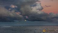 Full moonrise over Pacific Ocean at Shipwreck Beach in Poipu in Kauai, Hawaii, USA