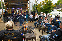 Sitting around the fire pits and dancing to The Tom Paquette Band on the Patio at the Big House on Saturday night during Biketemberfest in Weirs Beach.  (Karen Bobotas/for the Laconia Daily Sun)