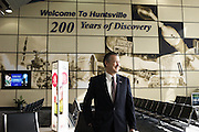 HUNTSVILLE, AL – APRIL 2, 2014: Executive Director Rick Tucker stands in the newly renovated waiting area at Huntsville International Airport. In an attempt to reverse the trend of declining service by airlines in small airports, Huntsville International Airport attempted to implement a rebate plan that would offer incentives to some carriers for enhanced service to the midsize city. The Federal Aviation Administration cautioned that the plan could potentially violate a federal law barring interference with airline fares, routes or service levels. When the industry's largest trade group, Airlines for America, threatened to, the airport's plan was disrupted. As major airlines continue to trim service offerings in smaller, less profitable cities, airports like Huntsville International struggle to attract and maintain carriers. CREDIT: Bob Miller for The Wall Street Journal<br />