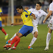 Christian Noboa, Ecuador, is challenged by Alejandro Bedoya, USA, during the USA Vs Ecuador International match at Rentschler Field, Hartford, Connecticut. USA. 10th October 2014. Photo Tim Clayton