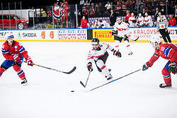 Thomas Rufenacht of Switzerland between Mathis Olimb of Norway and Mattias Norstebo of Norway during the 2017 IIHF Men's World Championship group B Ice hockey match between National Teams of Norway and Switzerland, on May 7, 2017 in Accorhotels Arena in Paris, France. Photo by Vid Ponikvar / Sportida