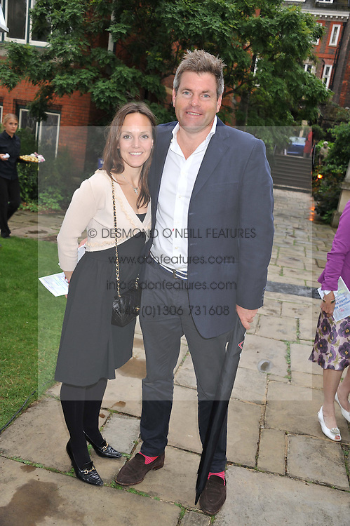 MARK DURDEN-SMITH and his wife RACHEL at The Lady Taverners 25th Anniversary Westminster Abbey Garden Party held in The College Gardens, Westminster Abbey, London o 11th July 2012.