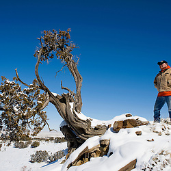 020311      Brian Leddy.Rancher Justin Yazzie stands on a ridge overlooking land that he and his family have raised cattle on since the 1950's. Now, due to new rules, Yazzie may be forced off the land.