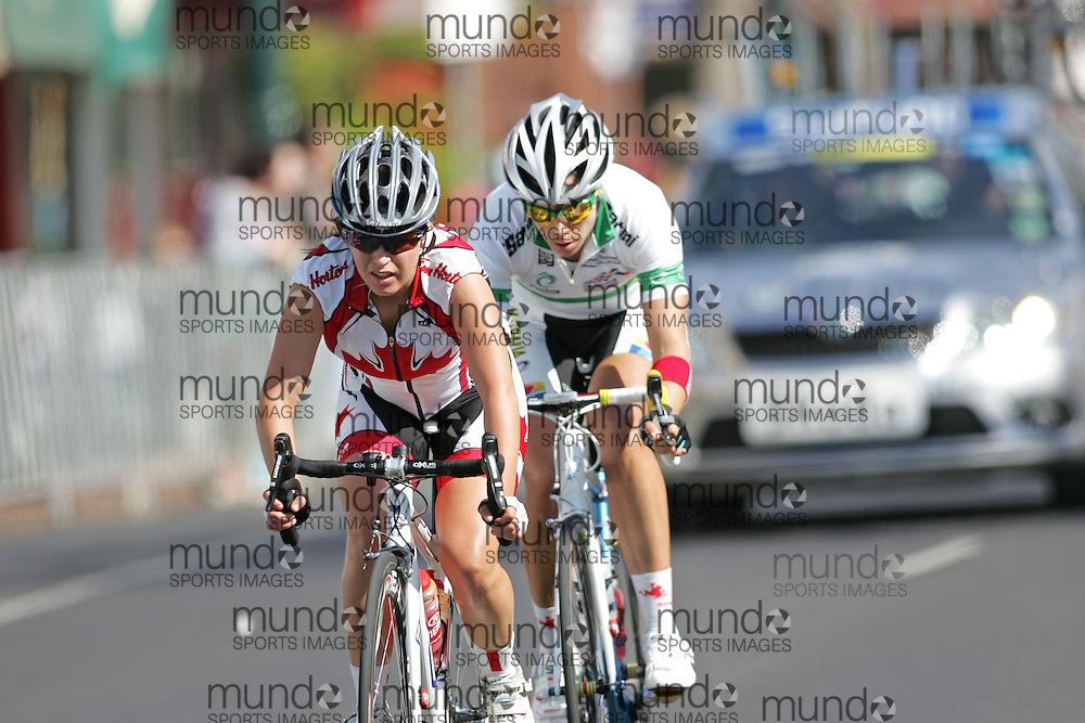 (Geelong, Australia---2 October 2010) Karol-Ann Canuel of Canada leads Bridie O'Donnell of Australia down Packington Street rides down Packington Street during the Elite Women's Road Race at the 2010 UCI Road World Championships.  [2010 Copyright Sean Burges / Mundo Sport Images -- www.mundosportimages.com]