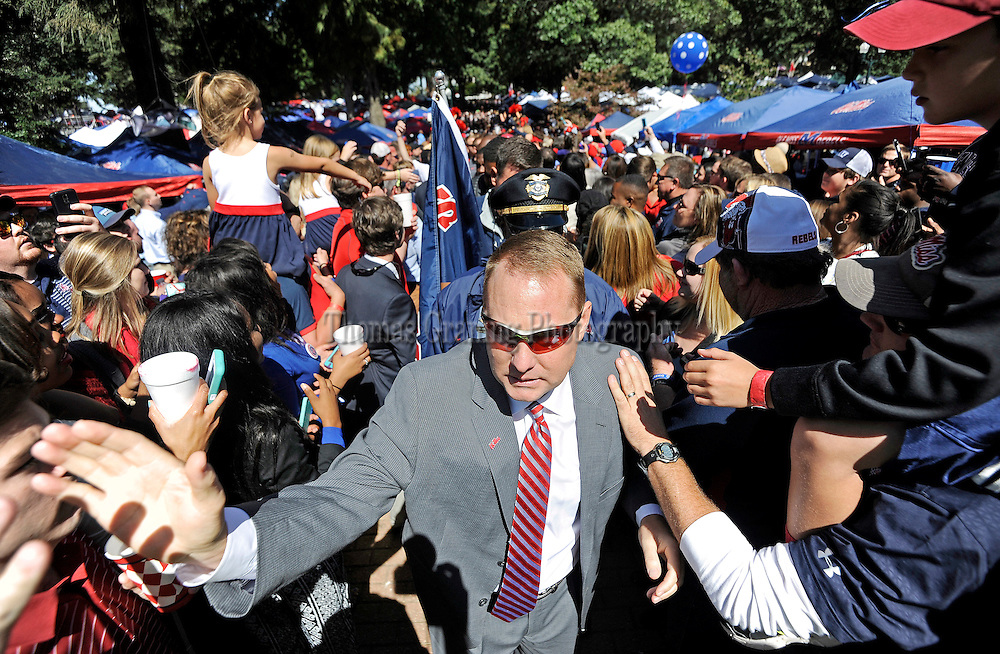 Mississippi head coach Hugh Freeze leads the Walk of Champions before an NCAA college football game between Mississippi and Alabama in Oxford, Miss., Saturday, Oct. 4, 2014. (Photo/Thomas Graning)