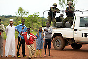 Members of the Rapid Intervention Battalion (Bataillon d'Intervention Rapide) watch over the crowd during the visit of UNICEF Goodwill Ambassador Mia Farrow at the Bazzama primary school in the town of Bazzama, Cameroon on Wednesday September 16, 2009.  The school integrates the children of refugees from Central African Republic with residents from the area..