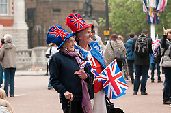 LONDON, UK  29/04/2011. The Royal Wedding of HRH Prince William to Kate Middleton. Two women dressed for the Royal Wedding on The Mall. Photo credit should read MICHAEL GRAAE/LNP.